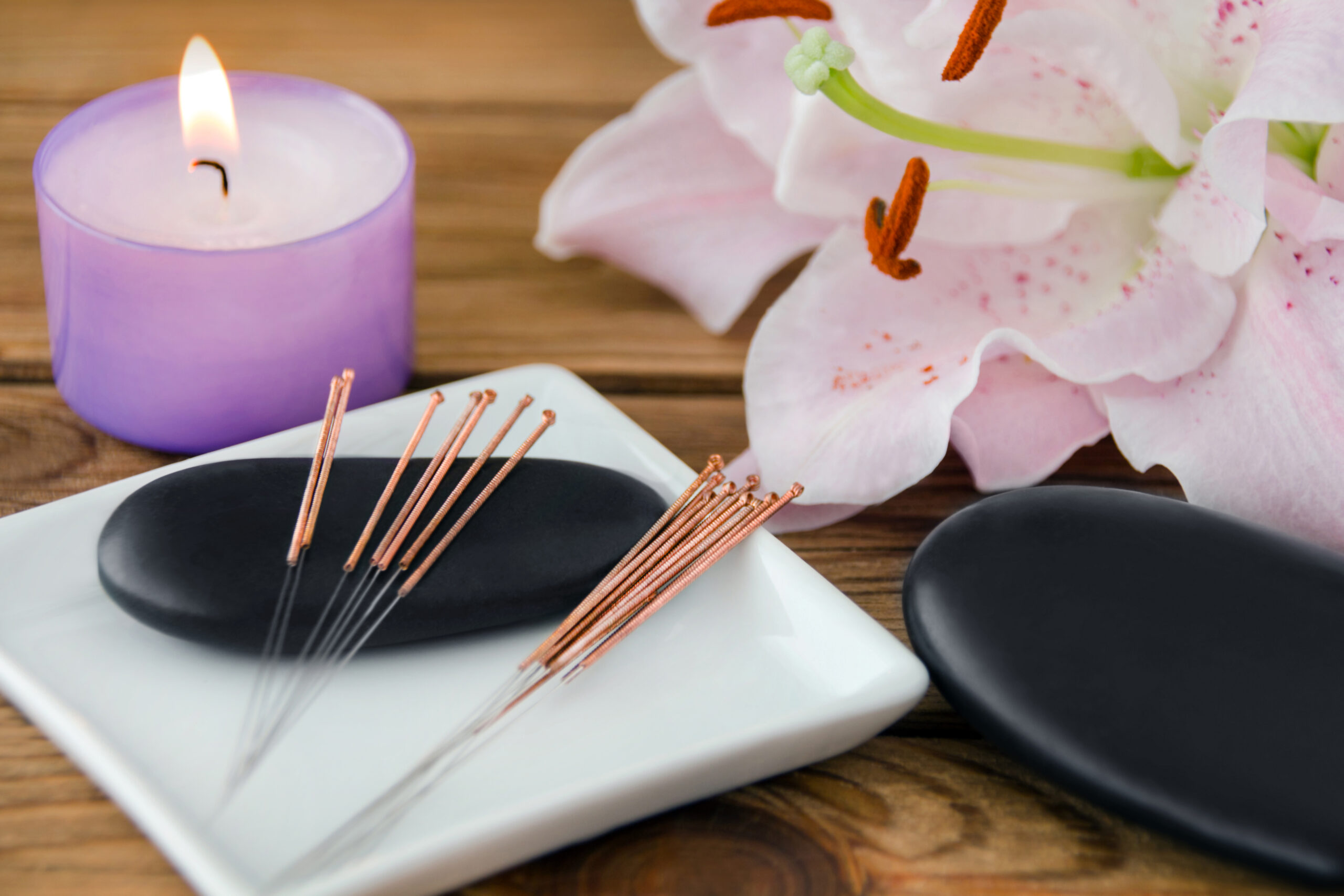 Acupuncture and Hot Stone Massage background